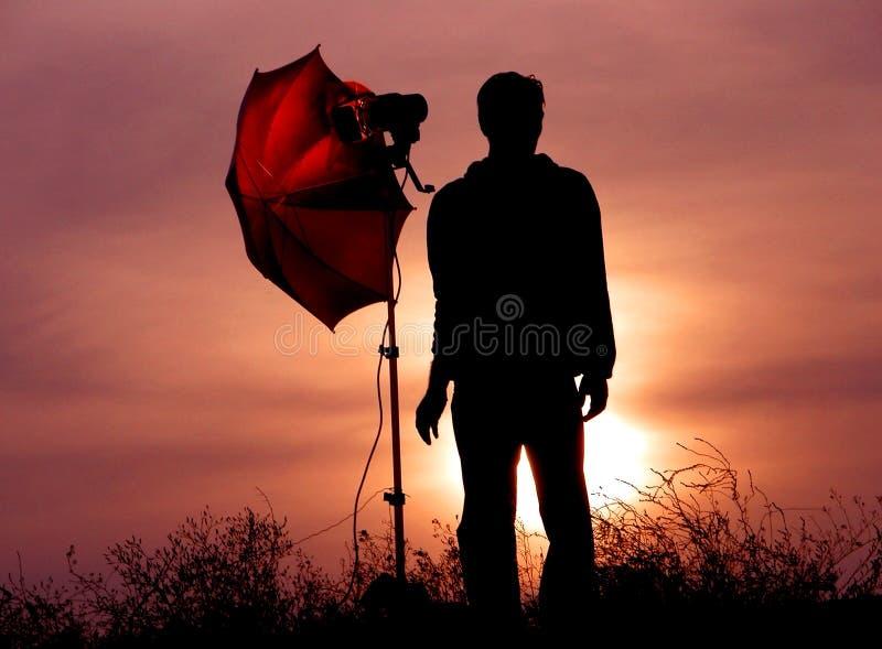 Photographer at dusk stock photo
