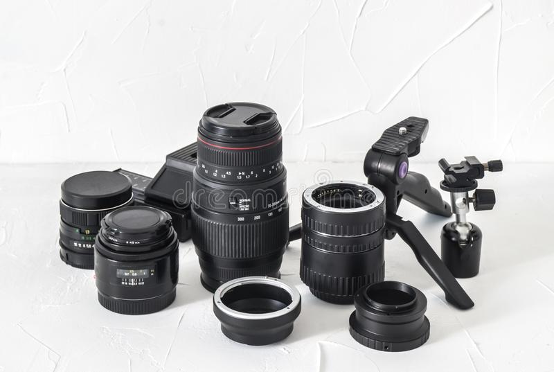 Photographer equipment: lenses, tripods, adapters, macro rings, macro rails on a white background. royalty free stock image