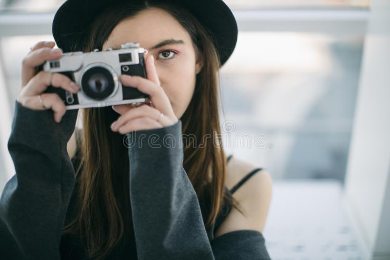 Photographer eyes. Beautiful ypung woman. Creative hobby and job. Lovely teen woman royalty free stock photo