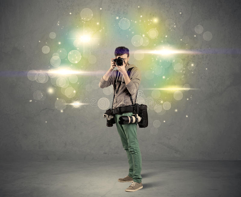 Photographer with flashing lights stock photos