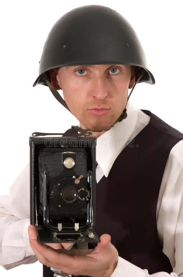Photographer in helmet keeps get old camera stock photo