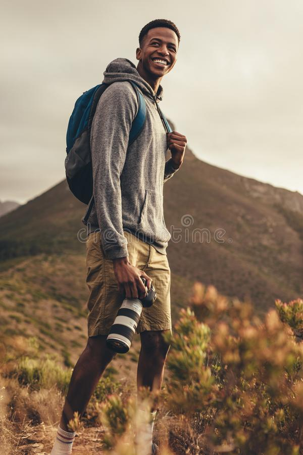 Photographer on hike for social media content stock photos