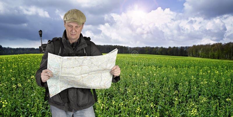 Photographer hiker with map stock photos