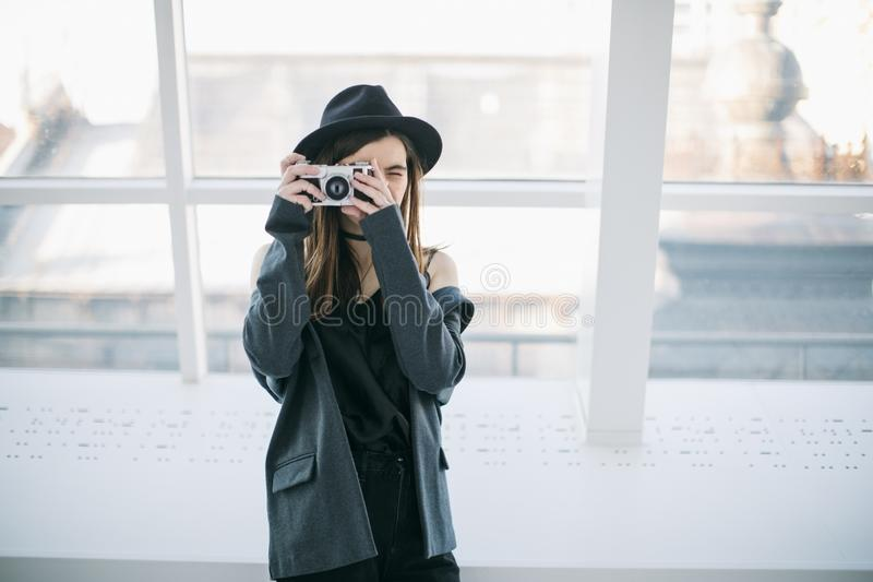 Photographer hipster woman in hat with retro cam. Creative mood. Stylish young lade royalty free stock image