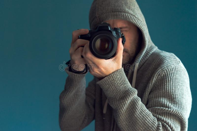 Photographer holding full frame sensor DSLR camera. And taking pictures stock photography