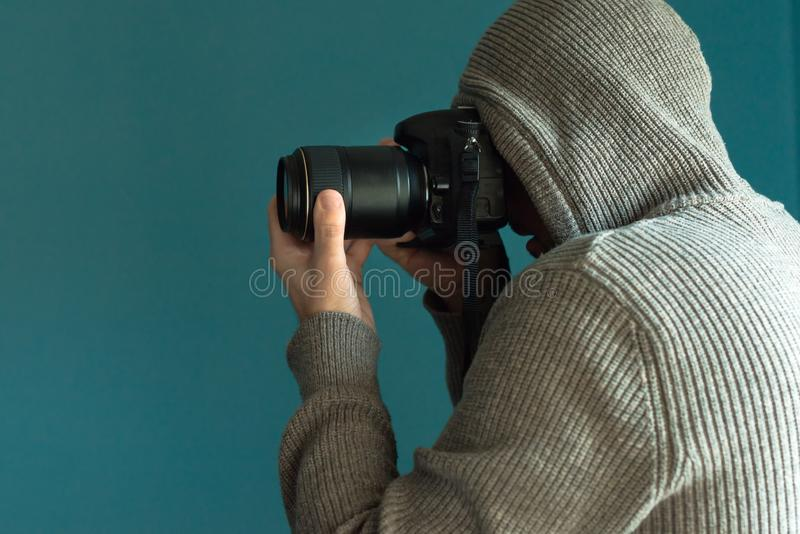 Photographer holding full frame sensor DSLR camera. And taking pictures royalty free stock photography