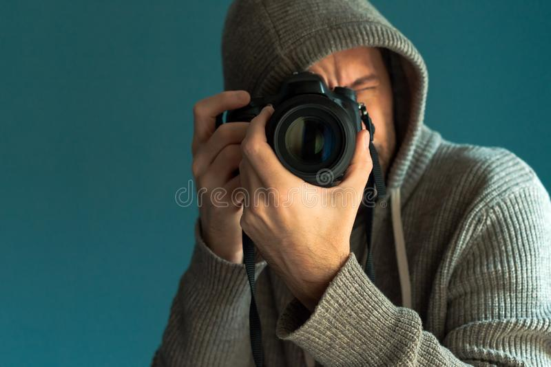 Photographer holding full frame sensor DSLR camera. And taking pictures royalty free stock images