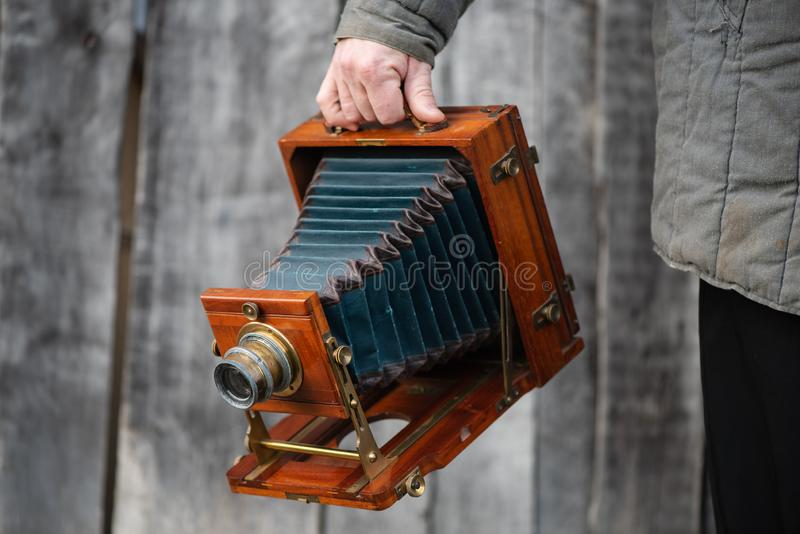 Photographer holds old large format studio camera, 5x7 inches. Concept - photography of the 1930s-1950s.  royalty free stock photography