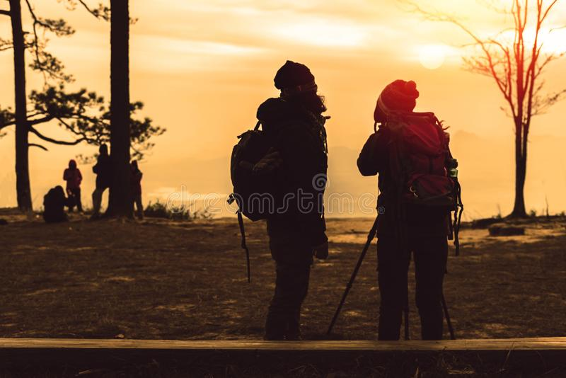 Photographer lover women and men asians travel relax in the holiday. Photograph mountain landscapes atmosphere in the morning. In stock photo