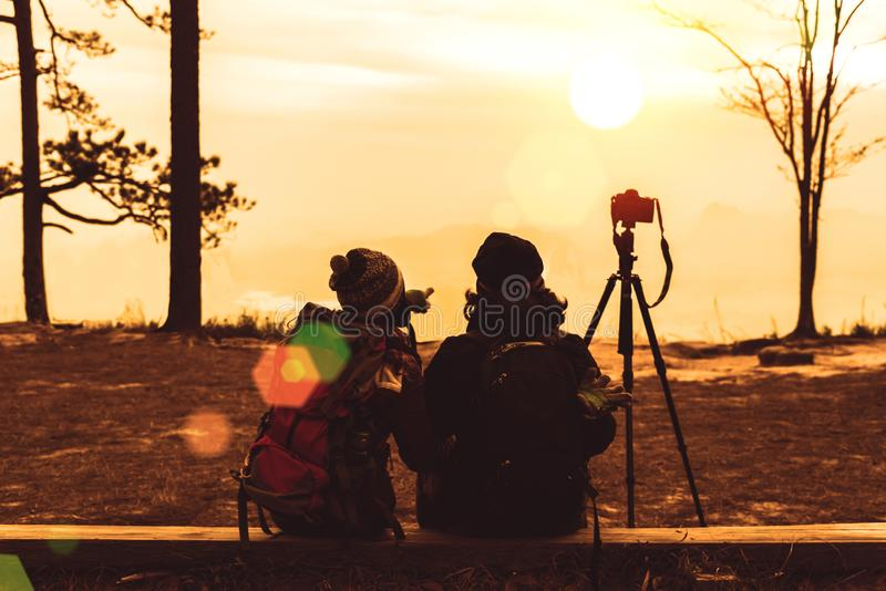 Photographer lover women and men asians travel relax in the holiday. Photograph mountain landscapes atmosphere in the morning. In stock images