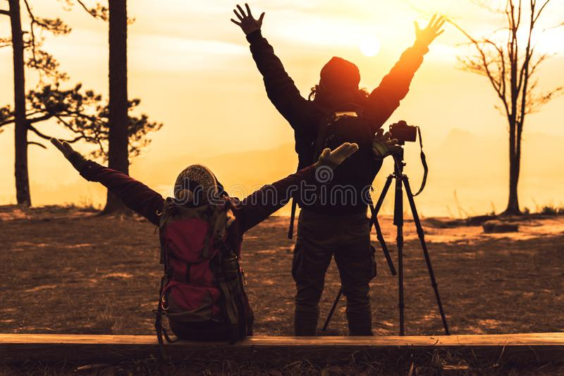 Photographer lover women and men asians travel relax in the holiday. Photograph mountain landscapes atmosphere in the morning. In royalty free stock photo