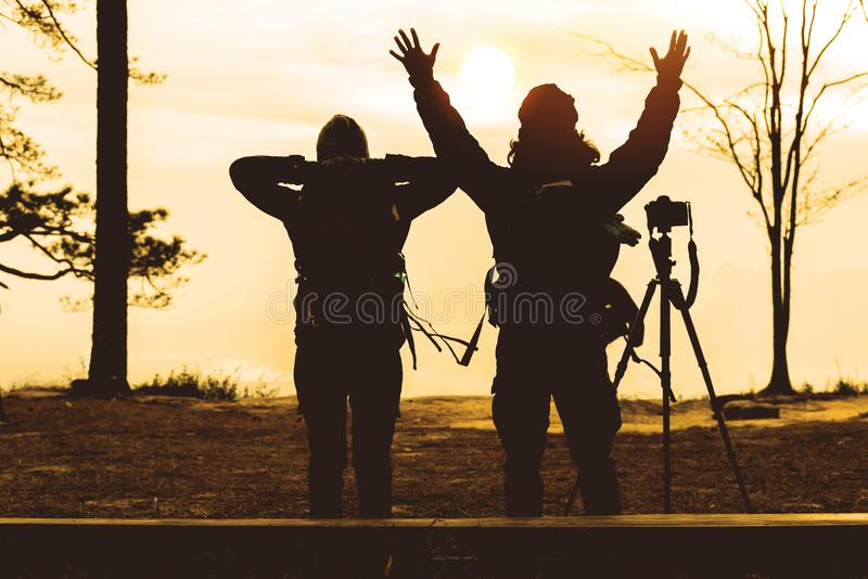Photographer lover women and men asians travel relax in the holiday. Photograph mountain landscapes atmosphere in the morning. In royalty free stock images