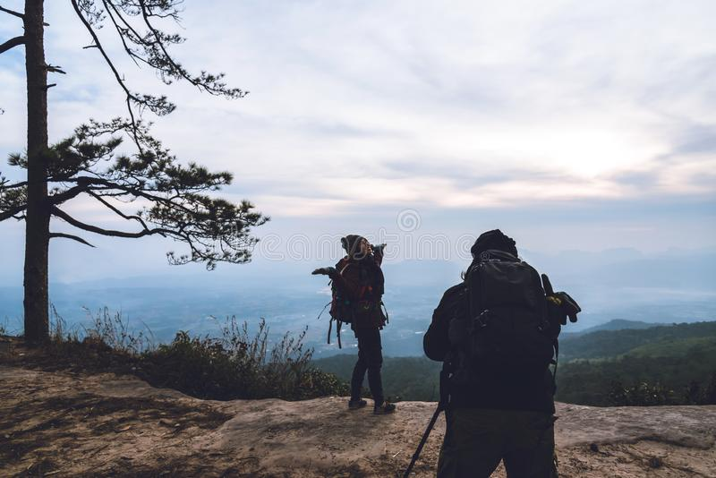 Photographer lover women and men asians travel relax in the holiday. Photograph mountain landscapes atmosphere in the morning. In royalty free stock photos