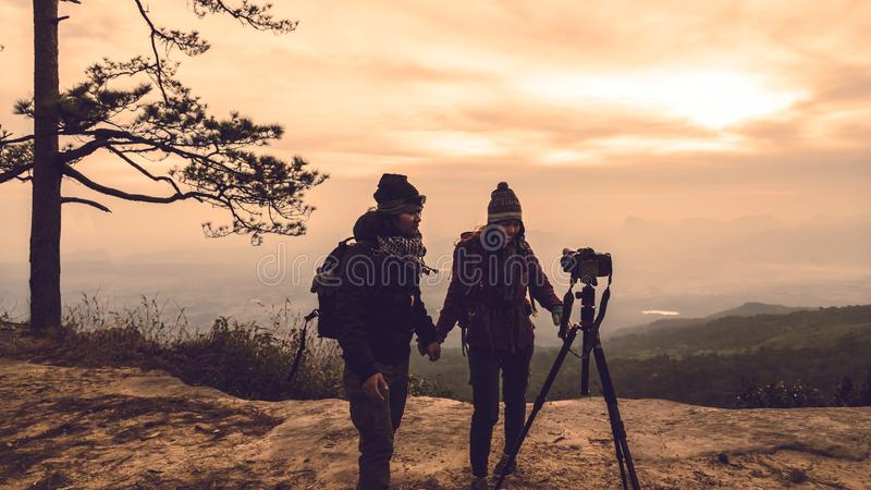 Photographer lover women and men asians travel relax in the holiday. Photograph mountain landscapes atmosphere in the morning. In stock photography