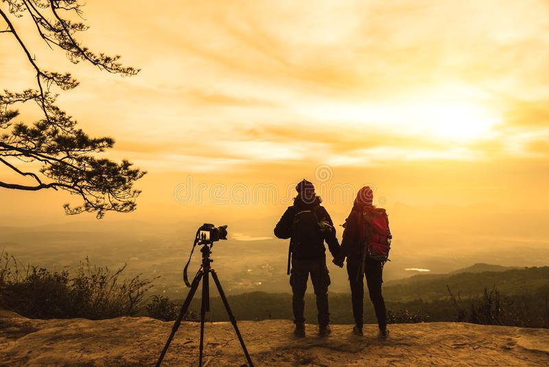 Photographer lover women and men asians travel relax in the holiday. Photograph mountain landscapes atmosphere in the morning. In stock image