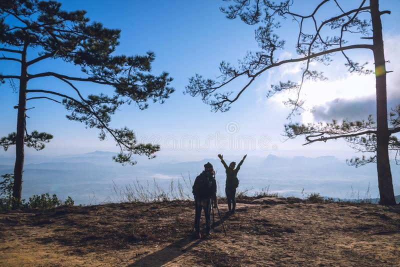 Photographer lover women and men asians travel relax in the holiday. Photograph mountain landscapes atmosphere in the morning. In. The winter. summer royalty free stock photo