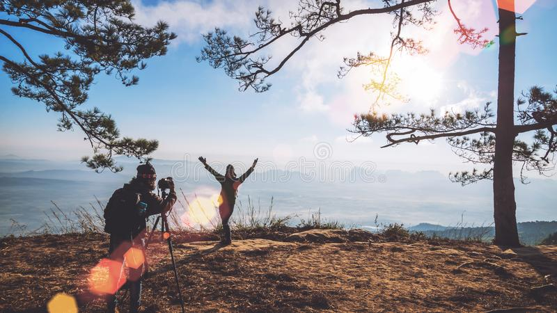 Photographer lover women and men asians travel relax in the holiday. Photograph mountain landscapes atmosphere in the morning. In. The winter. summer stock photo