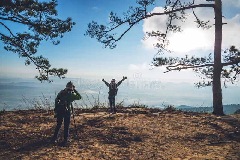 Photographer lover women and men asians travel relax in the holiday. Photograph mountain landscapes atmosphere in the morning. In. Photographer lover woman and royalty free stock images