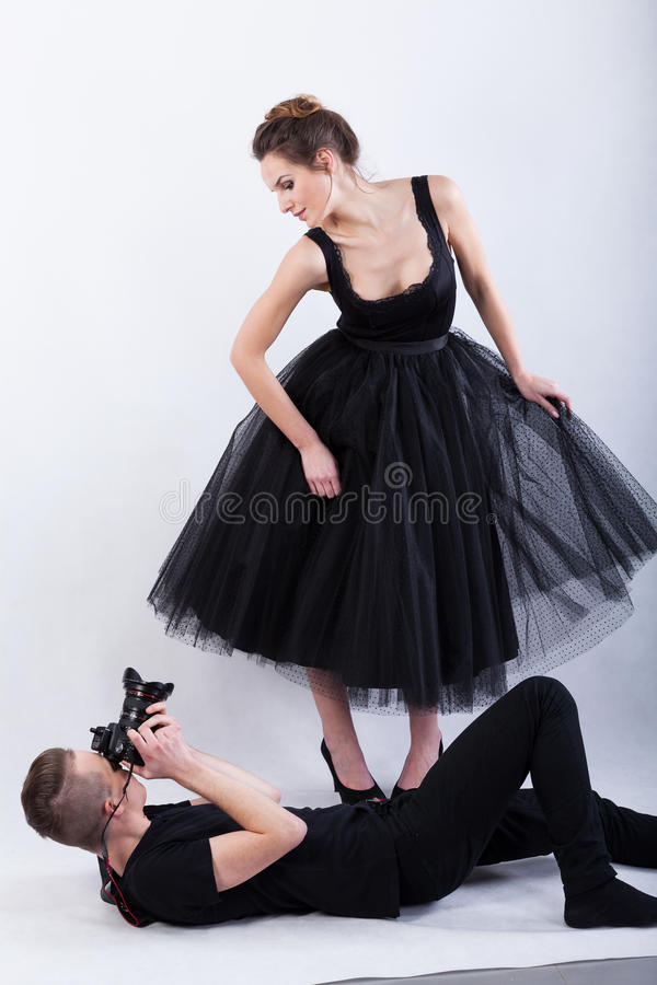 Photographer lying on the floor and taking a photo royalty free stock images