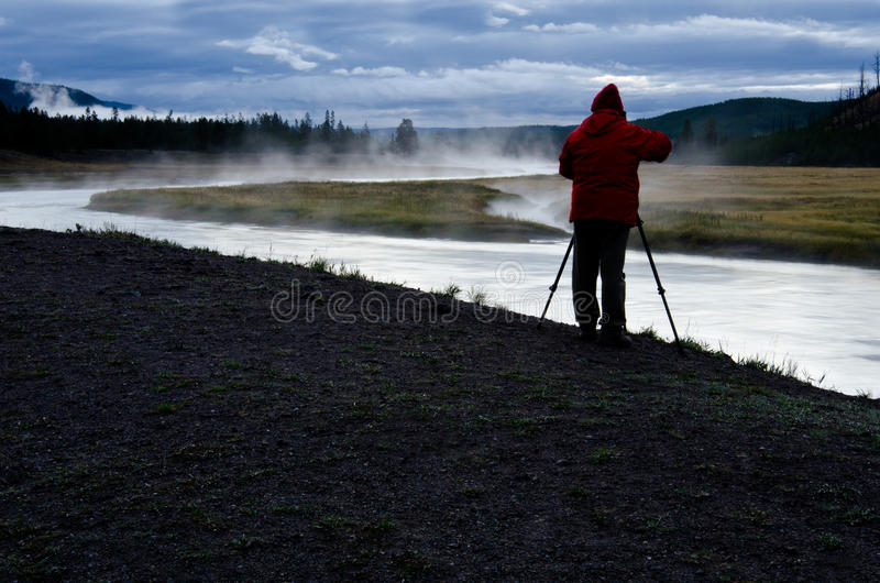 Photographer on Madison River in Yellowstone National Park stock images
