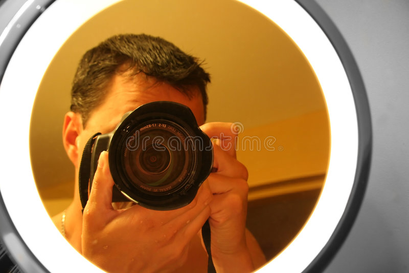 Photographer In The Mirror Stock Photo