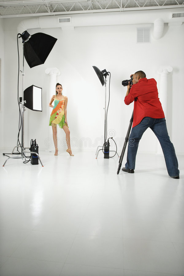 Photographer with a model. royalty free stock image