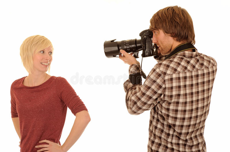 Photographer with model. Half body portrait of young photographer taking picture of young blond model, isolated on white background with copy space stock photo