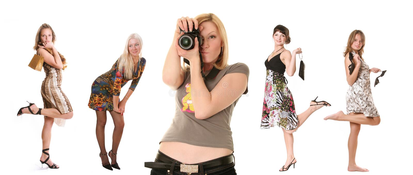 Photographer and models. Group of beautiful young women and photographer stock image