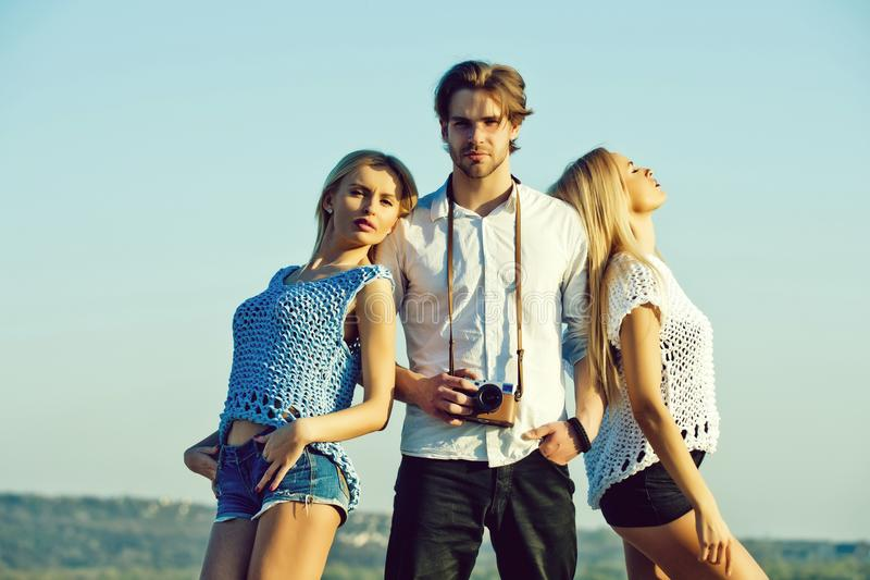 Photographer with models. girls and man or photographer with camera royalty free stock photography