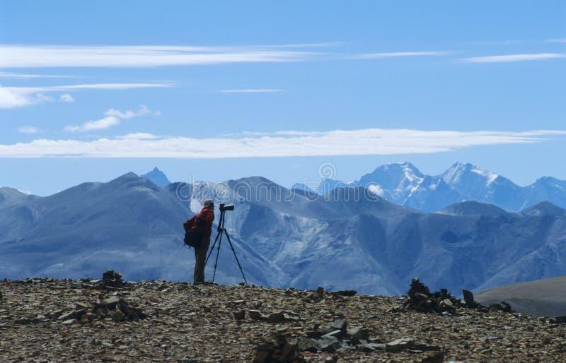 Photographer on plateau stock image
