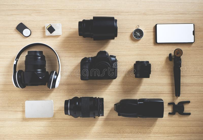 photographer's equipment and accessories on wood royalty free stock photo