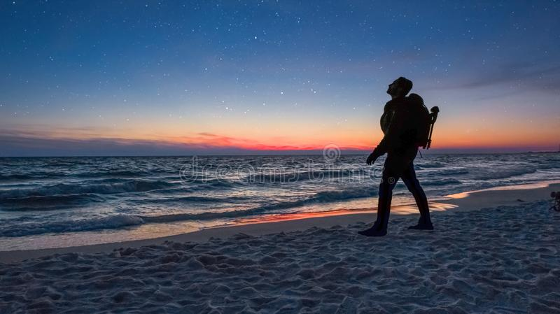 Photographer scouts out the best place to settle down for the night. stock photo