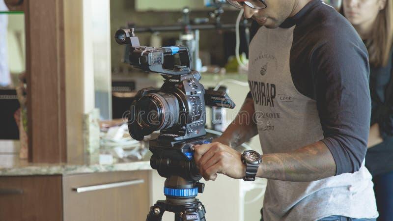 Photographer setting up stock photo