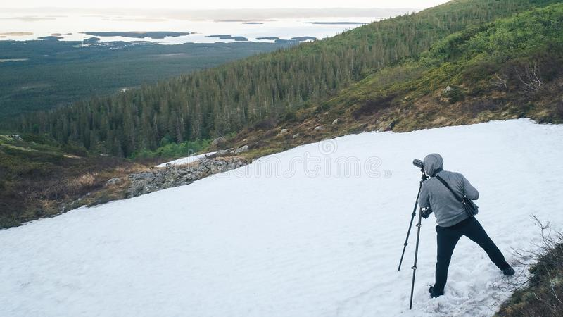 Photographer is Shooting in the Mountains stock photo