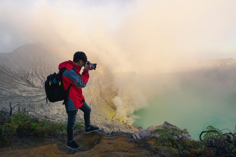 Photographer is shooting picture on top of mountain at sunrise s royalty free stock photography