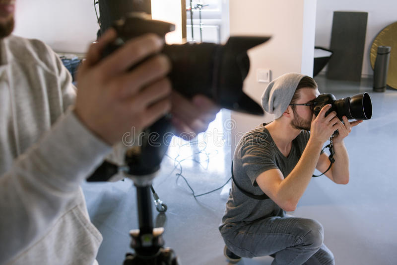 Photographer shooting at studio photo session stock images