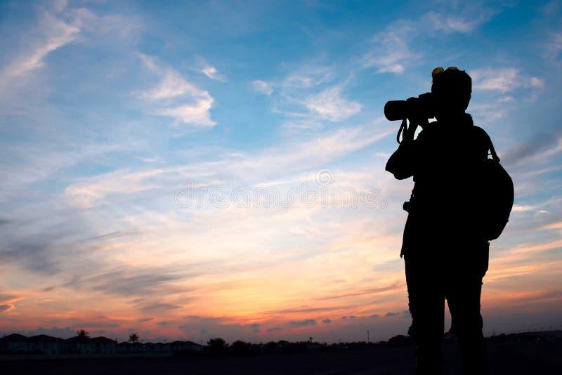 Photographer shooting sunset sky. Sunset royalty free stock photography