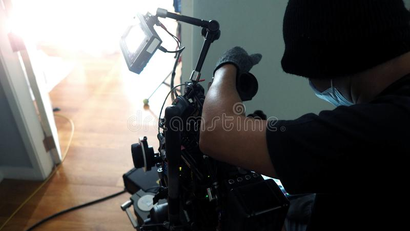 Photographer shooting video production with camera set. stock images