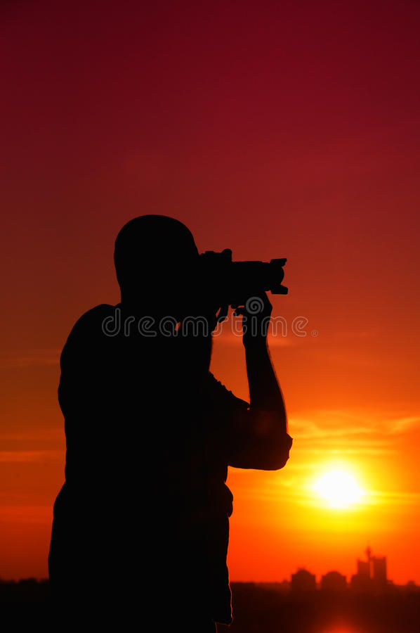 Download Photographer in sunset stock photo. Image of scenery - 27912100