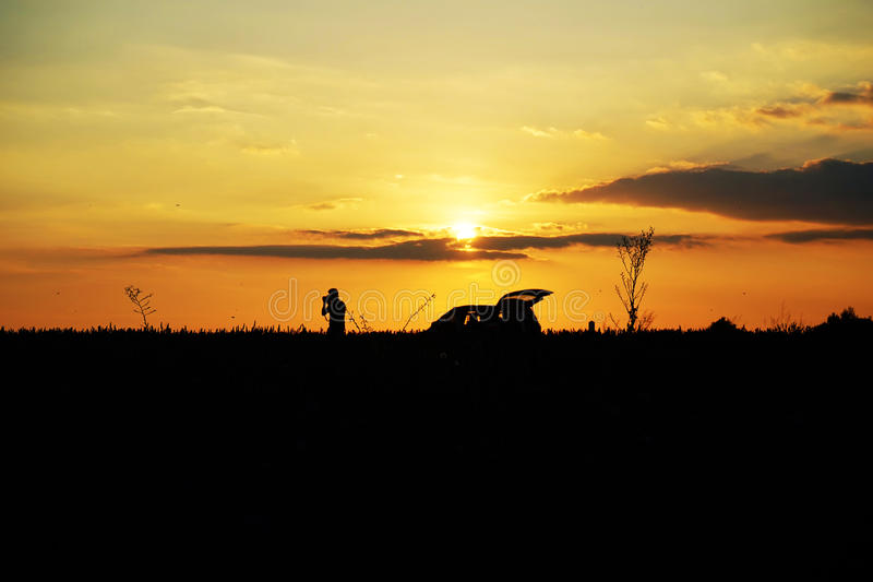 Photographer in the sunset royalty free stock photography