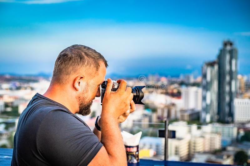 Photographer takes photos at pattaya city view. Photographer takes photos at pattaya city view royalty free stock image