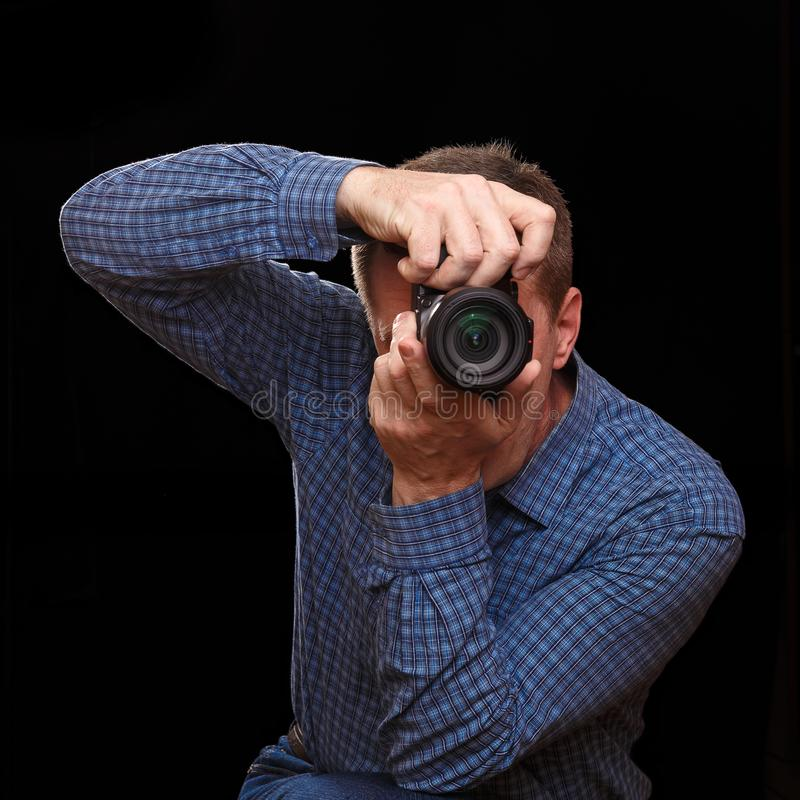 The photographer takes a picture by pointing the camera at the viewer stock image