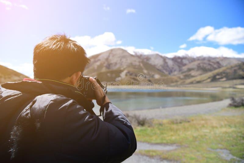 Photographer taking photo of landscape royalty free stock photography