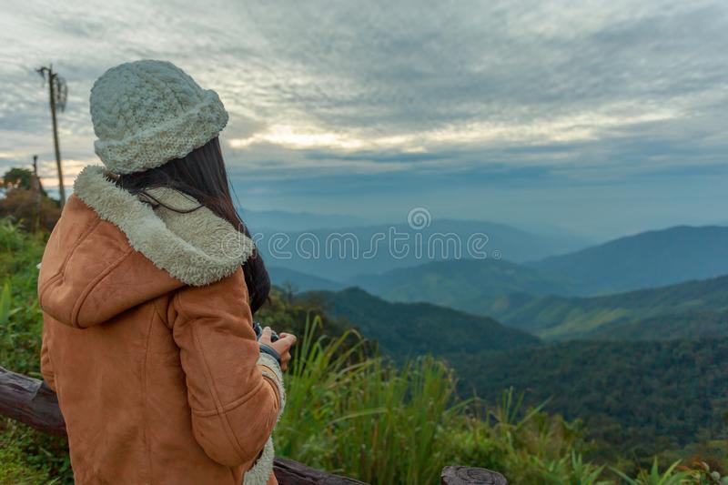 Photographer taking photo of landscape from top of the mountain stock photo