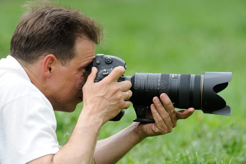 photographer taking photo in wild royalty free stock photography
