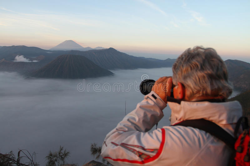 Photographer taking picture of Mount Bromo stock image