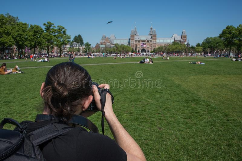 Photographer taking a picture of the Rijksmuseum royalty free stock image