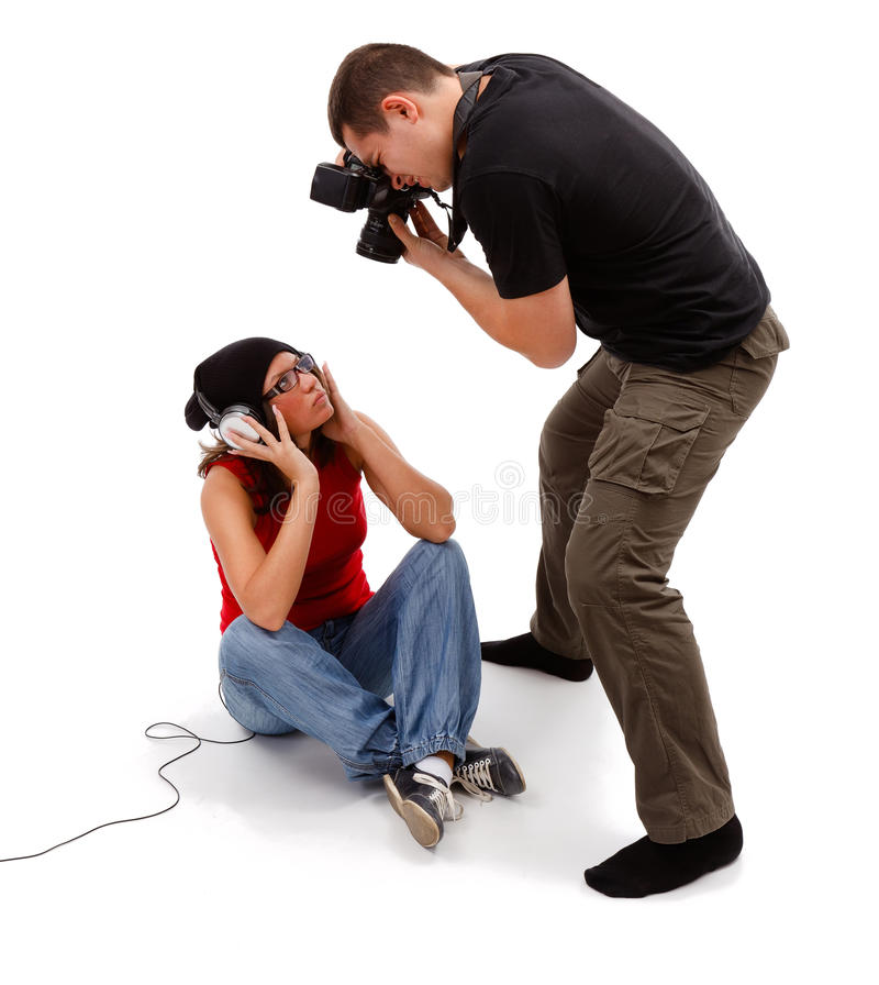 Photographer taking picture of sitting model stock images
