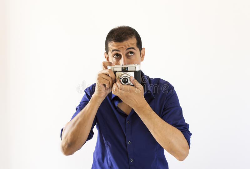 Download Photographer Thinking About His New Instant Stock Photo - Image of paparazzi, holding: 34670802