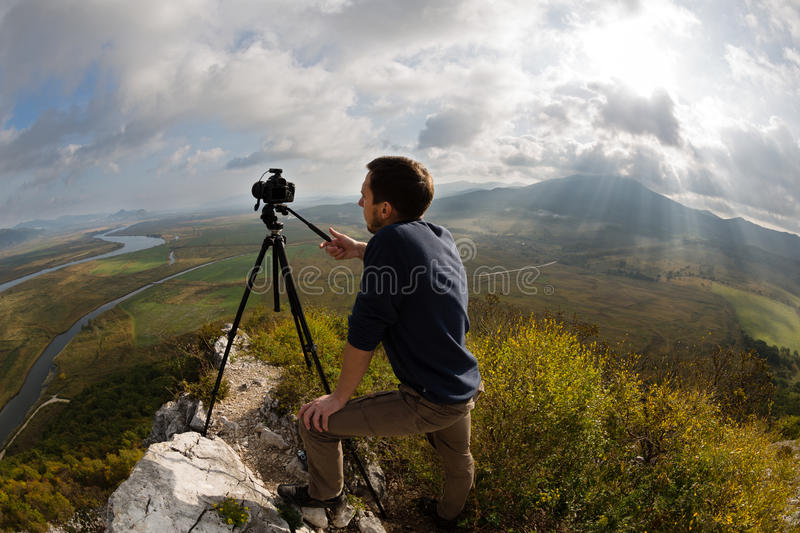 Photographer on top of the mountain stock photos